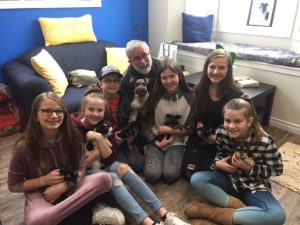 Italia family holding Talia and her six pups